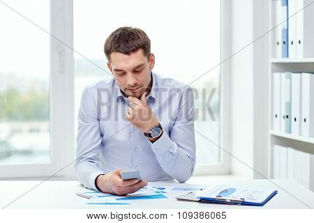 business, people and technology concept - close up of businessman with smartphone