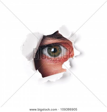 Spy eye watching through a hole isolated
