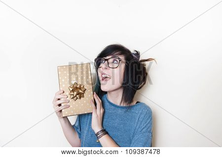Pretty Young Woman Cheerful With Gold Gift Pack
