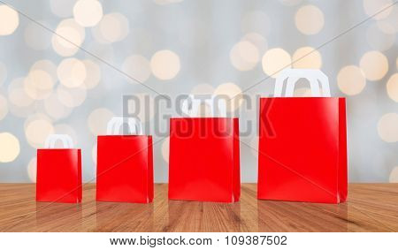 sale, consumerism, advertisement and retail concept - many blank red different size shopping bags