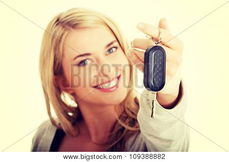 Portrait of happy woman holding a car key.