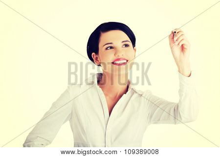 Happy businesswoman drawing on a glassboard