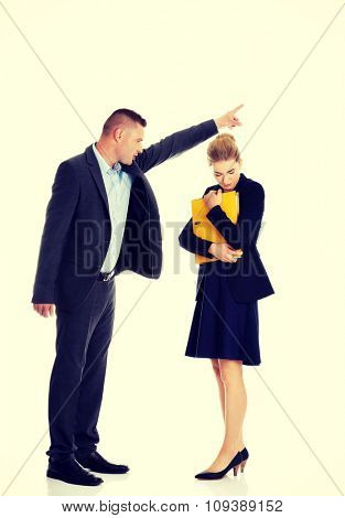 Businessman screaming at a colleague from a company
