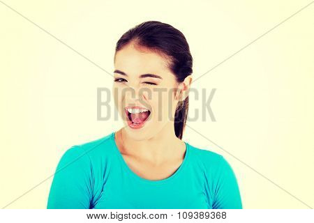 Portrait of a woman blinks her eye.
