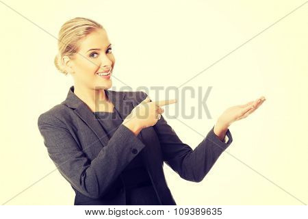 Business woman showing copy space on the left.