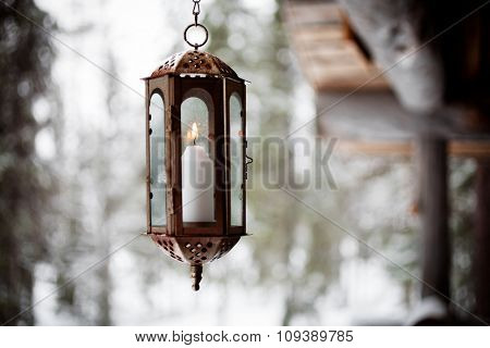 Christmas lantern hanging from porch
