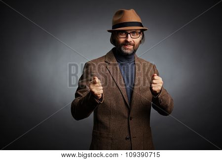 Mature man in stylish casual-wear looking at camera