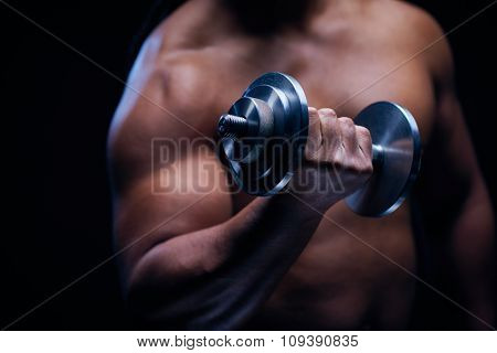 Young man with barbell practicing physical exercise