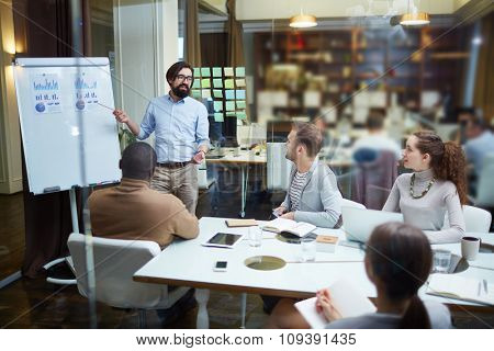 Bearded businessman making presentation at meeting