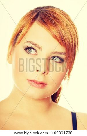 Plus size woman thinking about an idea