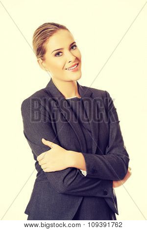 Businesswoman standing in confident pose.