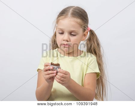 Four-year Girl Eats A Chocolate Sweet Tooth