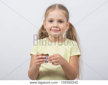 Portrait Of A Four-year Girl Sweet Tooth With Chocolate In Hand