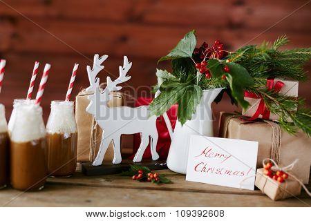 Christmas symbols and drinks on table