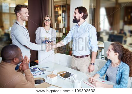 Successful businessmen handshaking after making agreement