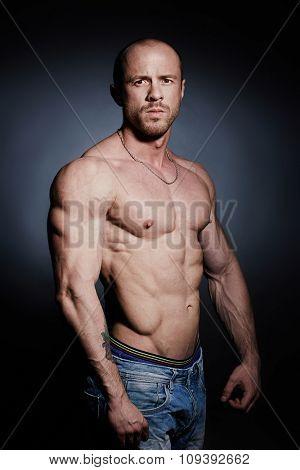 Shirtless athlete looking at camera