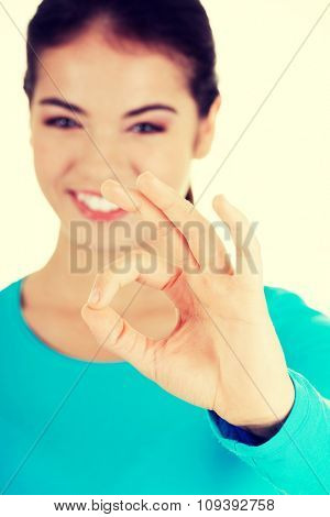 Portrait of a woman showing ok sign.