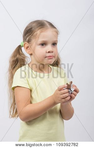 Portrait Of A Four-year Girl With Chocolate In Hand