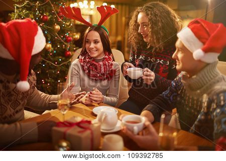 Group of young friends spending Christmas evening together
