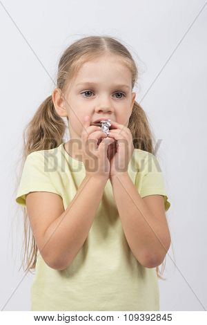 The Little Girl Eats A Chocolate Sweet Tooth