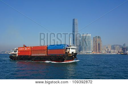 A Cargo Ship In Victoria Harbor Of Hong Kong