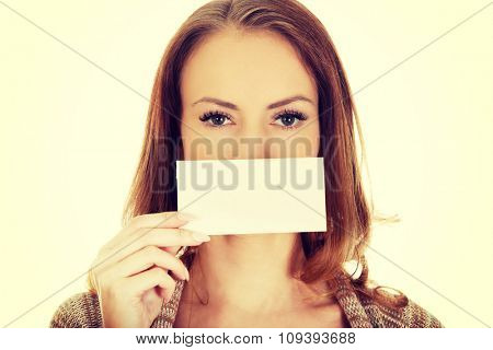 Beautiful happy woman with blank paper.