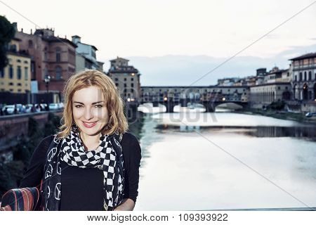 Young Woman Posing In Front Of Amazing Bridge Ponte Vecchio, Florence