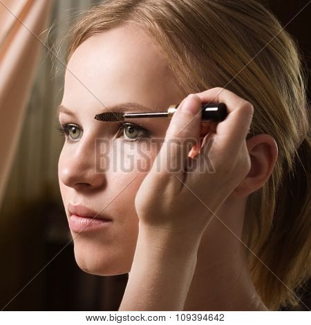 Make-up Artist Applying Liquid Eyeliner With Brush