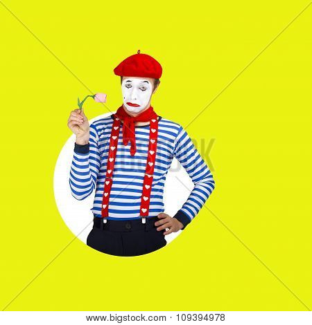 Sad male mime with flowers.Funny actor in red beret, sailor suit poses on color background