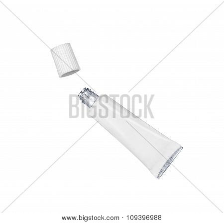 Glue To The Lashes In A White Tube In The Air On An Isolated Background