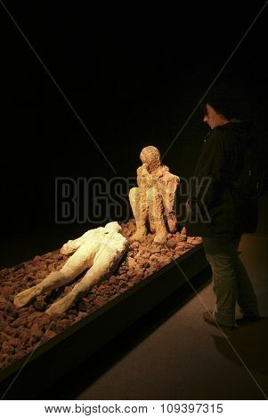 Visitor Observing Human Victim Body Cast