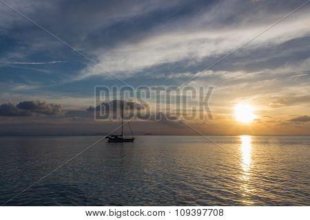 Lone Yacht Near The Tropical Island
