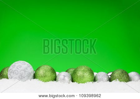 Christmas baubles decor and green background for copy space