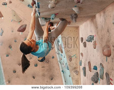 Woman Practicing In Climbing Gym