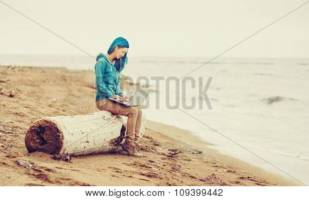 Working On Laptop On Beach