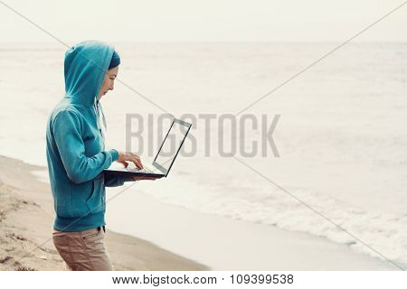 Freelancer Working On Laptop On Coast