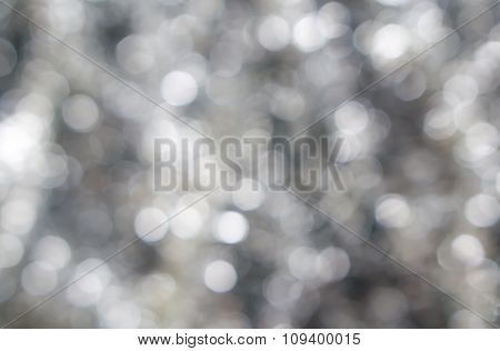 Abstract Blured Background Of Dark Contrast Silver White Shiny Christmas Tree Decorations
