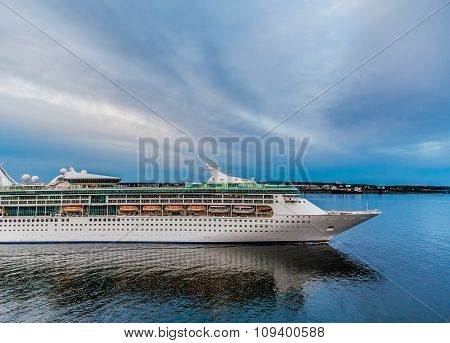 Cruise Ship Departing At Dusk