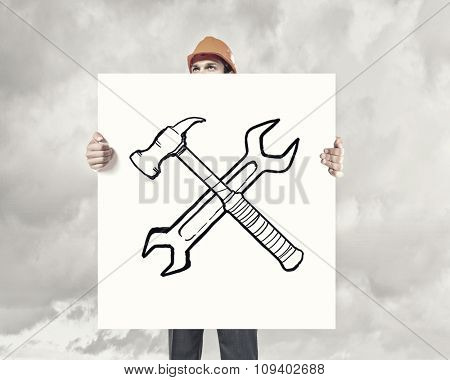 Man in helmet showing white banner with tool concept