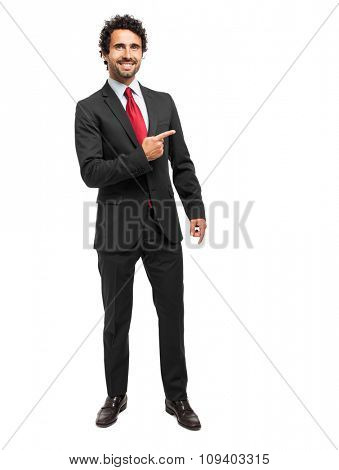 Handsome businessman pointing his finger to the right