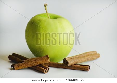 Ripe Green Apple With Cinnamon Sticks