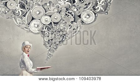 Young woman in white hat with opened book in hands and gears flying out