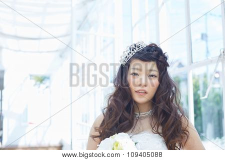Beautiful asian woman in elegant wedding dress