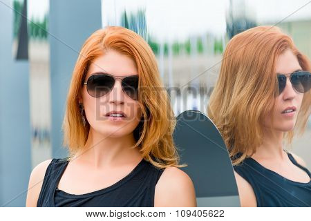Portrait Of A Woman In Sunglasses In The City