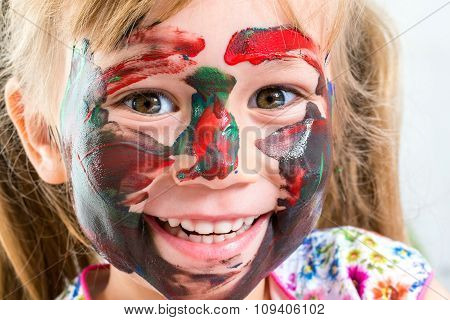 Face Shot Of Girl With Painted Face.