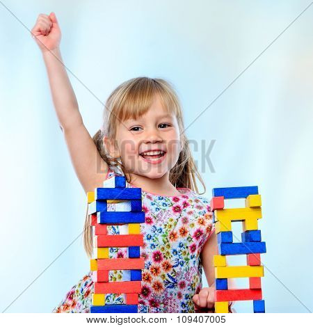 Happy Little Girl At Play Table.