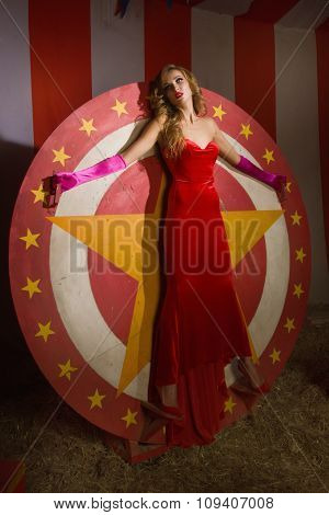 Circus Actress Stands On Circular Disc With Star