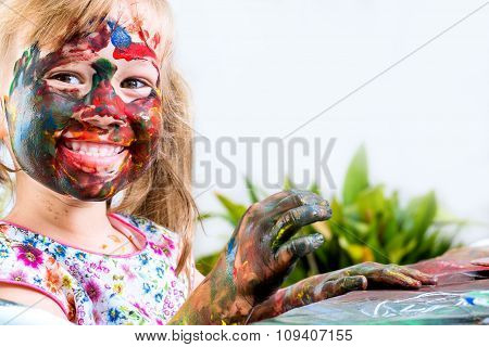 Happy Youngster Painting At Table.
