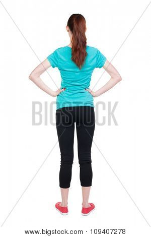 back view standing young beautiful  woman. girl  watching. Rear view people collection. backside view of person.  Isolated over white background. Hands behind his back runner is placing hands on belt.