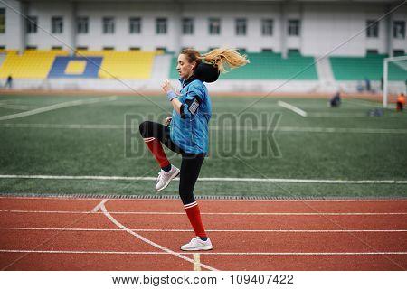 Female athlete training on stadium